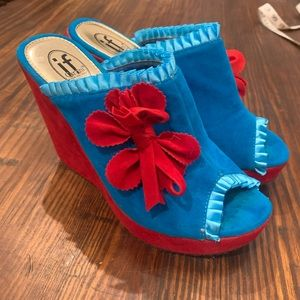 Red and turquoise velvet platform heels.